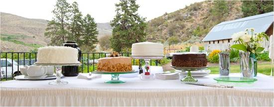 Delicious wedding reception dessert table with Washington mountains in background