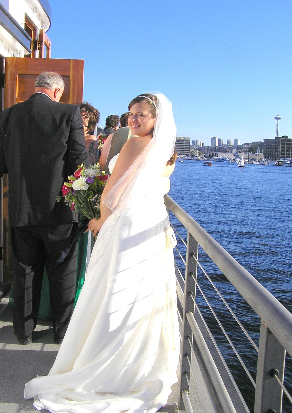 The bride gets ready to walk down the aisle on a ship.