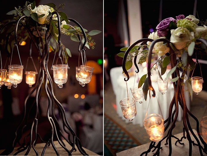 Romantic-wedding-flowers-wedding-reception-decor-ivory-purple-roses-hanging-tea-lights-wrought-iron-candelabra.full