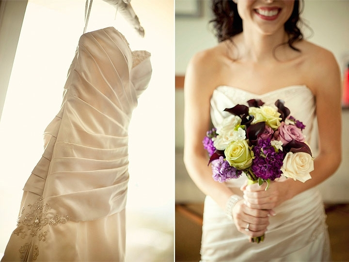 Bride in ivory stapless wedding dress, with pleating detail, holds plum, lilac, ivory bridal bouquet