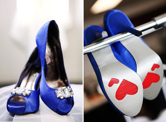 Navy blue satin peep-toe bridal heels with red hearts on sole