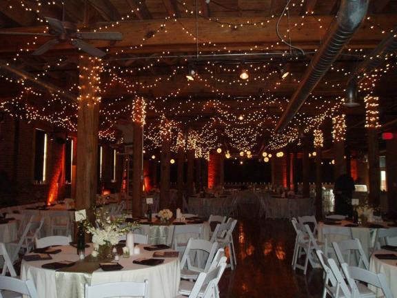 this christmas wedding is beautifully decorated with tiny christmas lights and white flowers