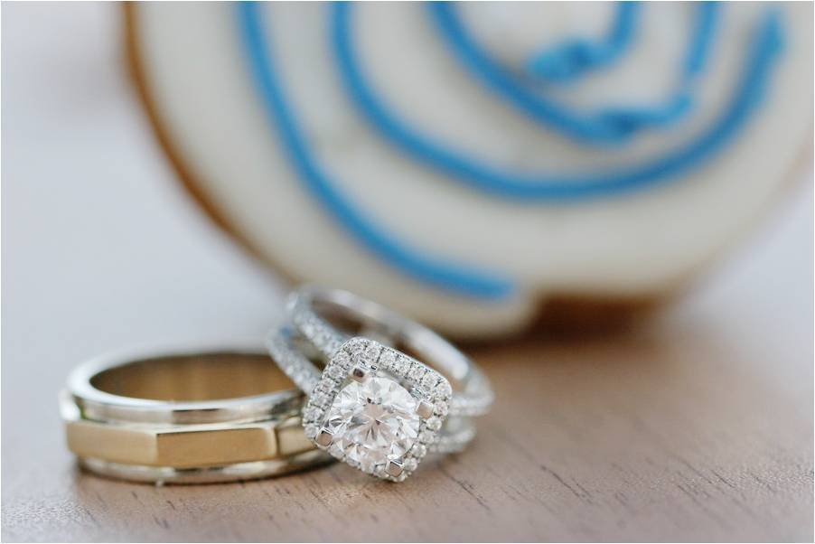 Nautical-themed-wedding-cushion-cut-diamond-engagement-ring-round-platinum-wedding-band-ring-shot.full