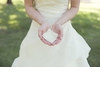 Bride-in-ivory-strapless-wedding-dress-holds-something-old-hankie-in-hands.square