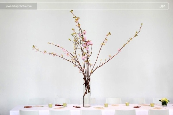 Eco-chic-green-wedding-minimal-wedding-reception-tablescape-white-cherry-blossoms-centerpiece.full