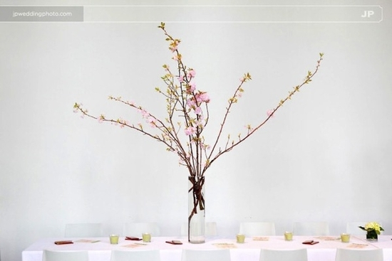 Minimal wedding reception decor and tablescape- all white with cherry blossom centerpiece