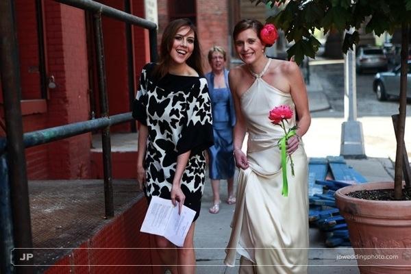 Eco-chic-green-wedding-bride-in-ivory-silk-satin-sheath-wedding-dress-walks-to-ceremony-with-maid-of-honor.full