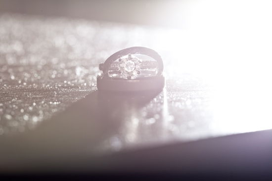 Artistic wedding photograph of the engagement ring and wedding band, using light and shadow