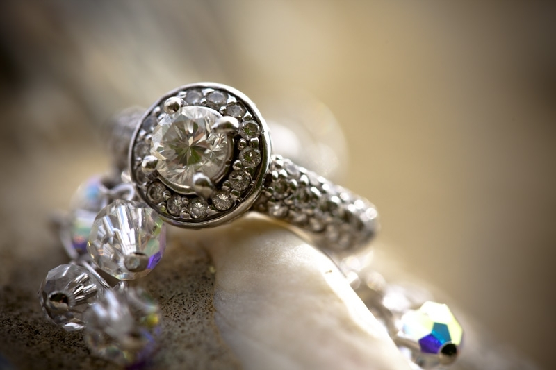 Antique engagement ring- center diamond set in pave cushion, engraved band