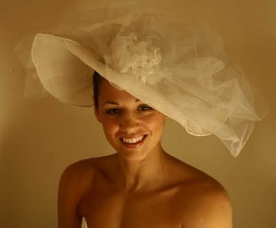 For the classic bride who wants to show her style savvy, the picture hat is the perfect bridal acces