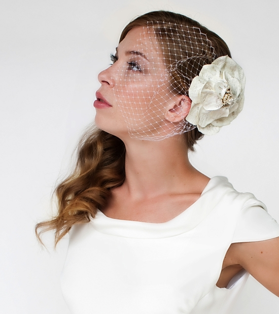 Sculptured flower bridal hairpiece in ivory cotton fabric with ivory veiling