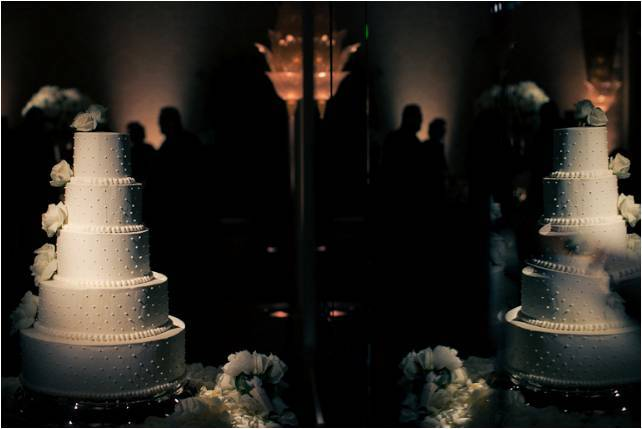 Classic-white-5-tier-round-wedding-cake-pearl-design-ivory-roses-cascading-down-side.full