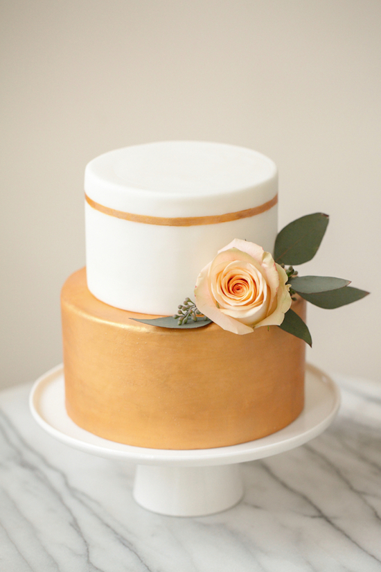 Gold Accented Wedding Cake with a Peach Rose