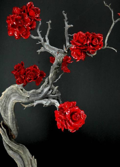 Organic-natural-wedding-reception-decor-fantasy-lipstick-red-roses-curled-branches.full