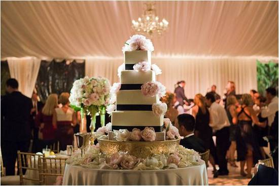 Gorgeous 5-tier square wedding cake with black ribbon accents and blush pink flowers