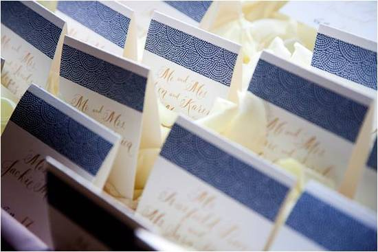 Luxe navy blue, gold, and ivory embossed escort cards