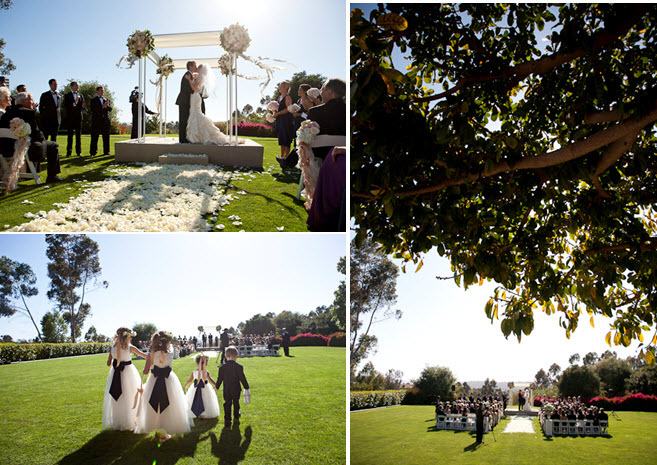 Outdoor wedding ceremony beneath gorgeous ivory and champagne arbor, with rose petals galore