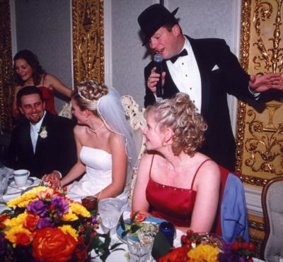 This Frank Sinatra impersonator serenades the bride and groom at their head table.