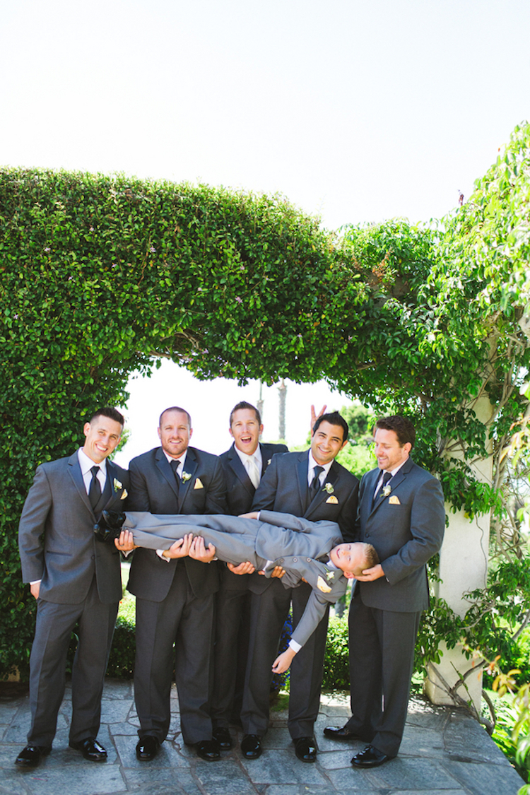 Groomsmen_holding_the_ring_bearer.full