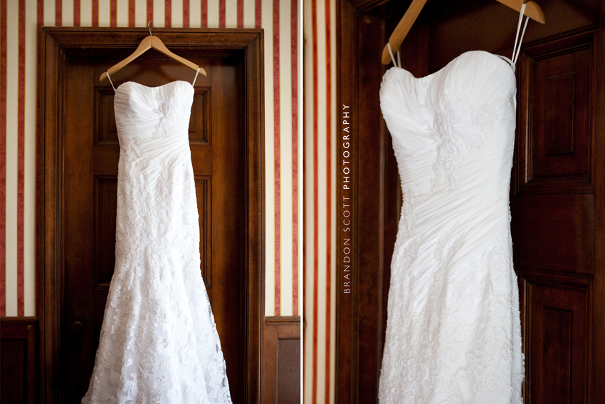 White-strapless-wedding-dress-with-lace-hangs-by-door.full