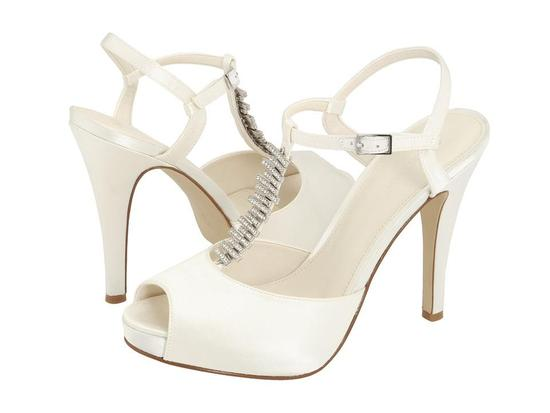 White peep toe bridal heels with t-strap adorned with rhinestone bling