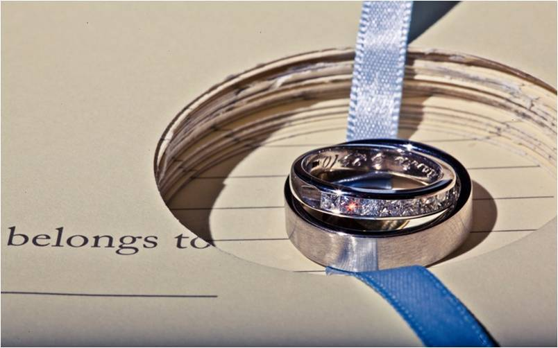 White gold wedding band (engraved) and diamond bridal band with blue ribbon