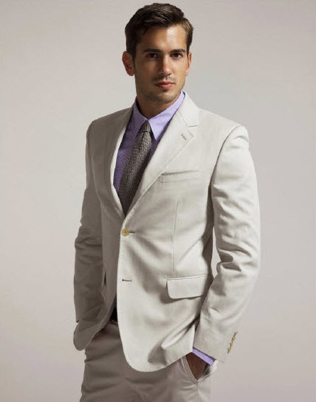 The perfect groomswear for a beach or destination wedding- khaki suit and light purple shirt and tie