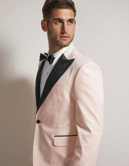 Quirky, stylish wedding day look for the Groom- a light pink tux jacket with black lapel