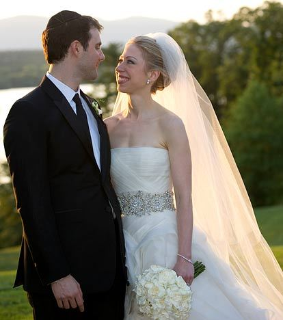 Chelsea-clinton-wedding-july-2010-vera-wang-strapless-wedding-dress-with-embellished-belt-burburry-tux-for-groom.full