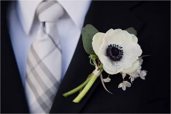 A chic modern boutinierre your groom will love- a single French white anemone