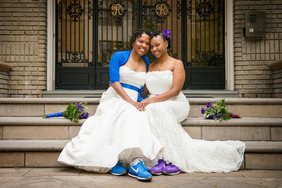 Two Brides In White with Blue and Purple Accessories