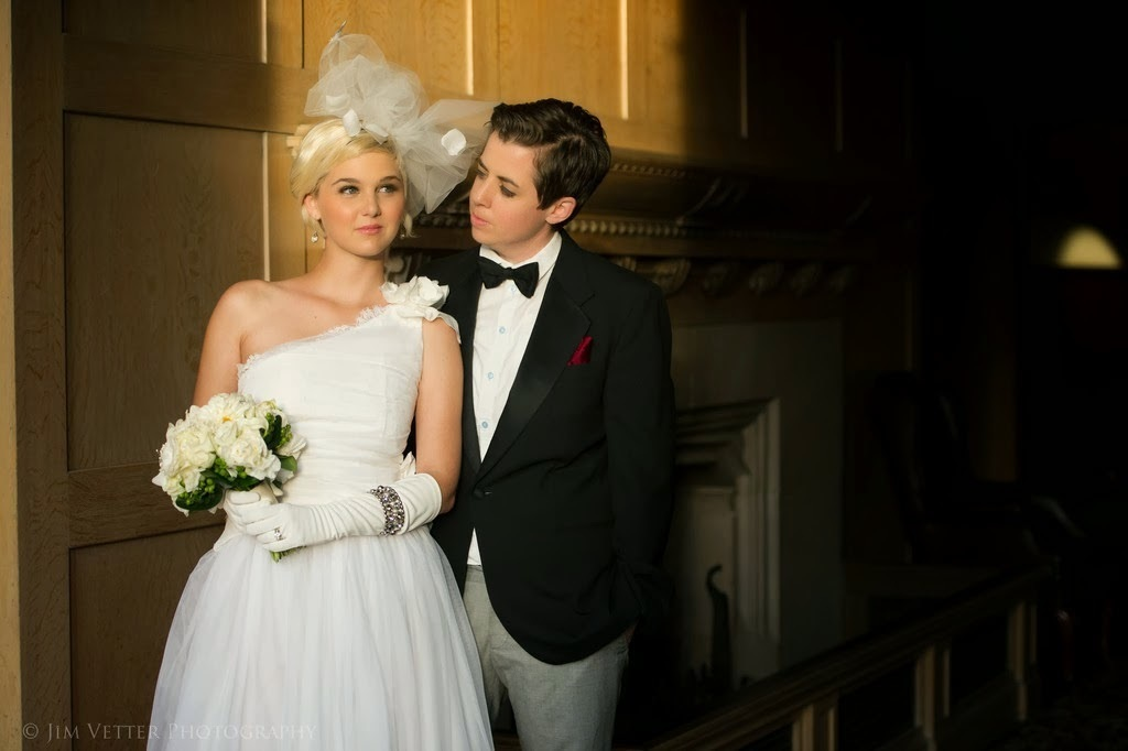 One_bride_in_a_suit_and_a_bride_in_a_gown.full