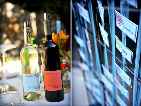 Custom wine labels with engaged couple's names add a personalized touch to their wedding reception