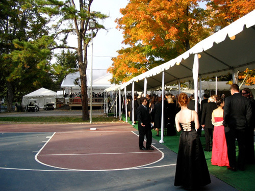 This black tie wedding took place on a basketball court, giving it an unusual feel.
