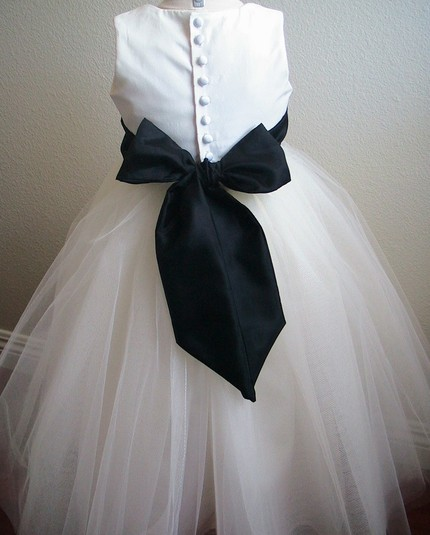 Chic ivory flower girl dress, shot of the back- covered buttons and full tulle skirt
