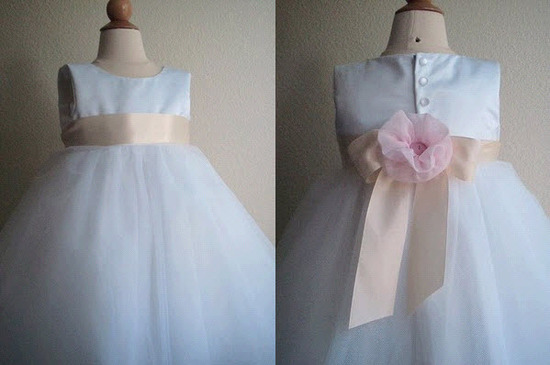 Adorable white flower girl dress with light pink sash and flower