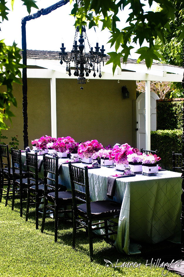 Hot-pink-black-chandelier-glam-outdoor-bridal-shower-purple-pink-low-table-centerpieces-flowers.full