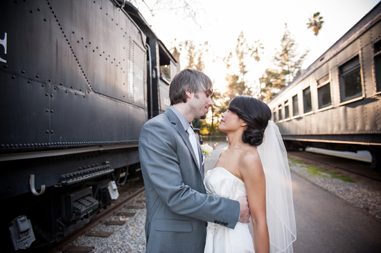 Real Bride and Groom Between Vintage Trains