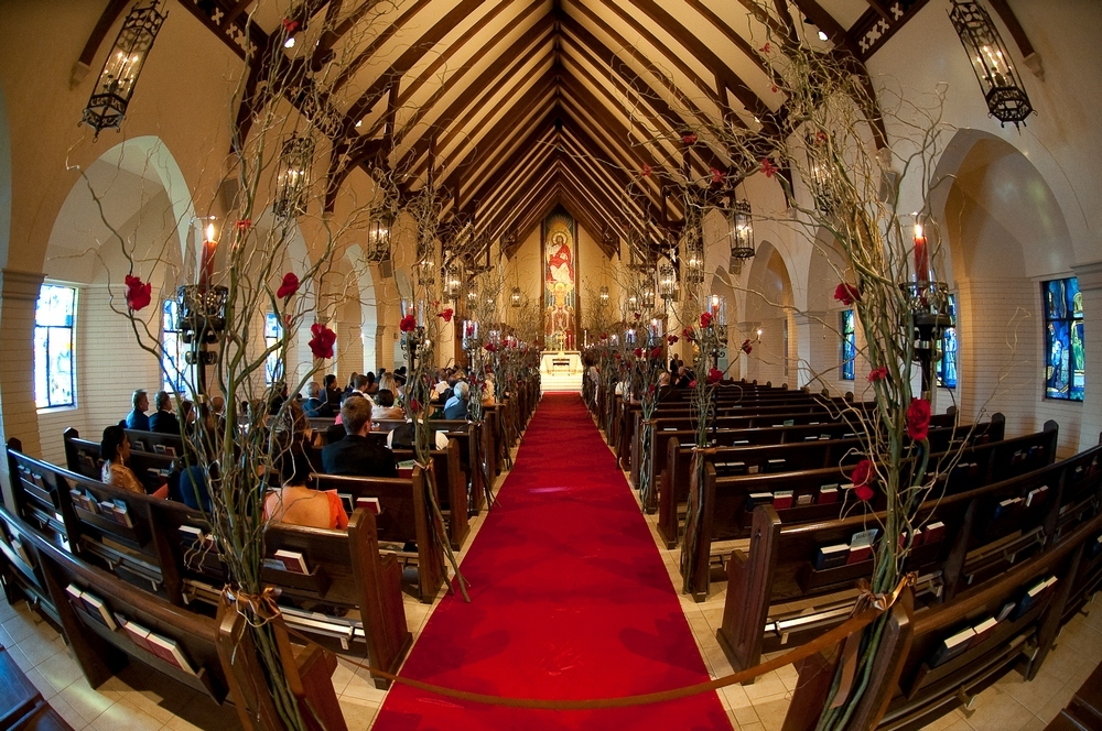 Regal-ornate-wedding-ceremony-venue-stain-glass-windows-in-church-red-carpet-aisle.full
