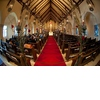 Regal-ornate-wedding-ceremony-venue-stain-glass-windows-in-church-red-carpet-aisle.square