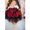 Bride-holds-statement-bridal-bouquet-deep-red-roses-black-feathers.square