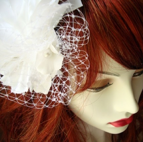 Statement-making poof veil fascinator is eco-friendly and super chic
