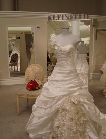 Kleinfeld-bridal-shop-designer-wedding-dresses-trunk-shows-asymmetric-neckline-ruffles.full