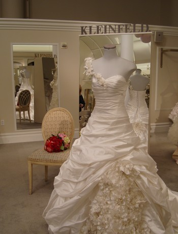 Stunning ivory asymmetric ballgown wedding dress with ruffled skirt by Pnina Tornai