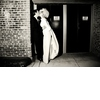 Black-white-artistic-wedding-photo-bride-vintage-bridal-look-kisses-groom-after-saying-i-do.square