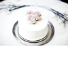 Mini-white-wedding-cake-with-blush-pink-roses-on-top-silver-tray.square