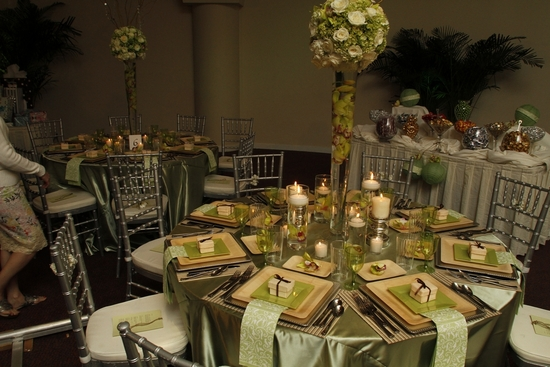 The enchanted garden wedding reception with a sage green and natural wood wedding color palette