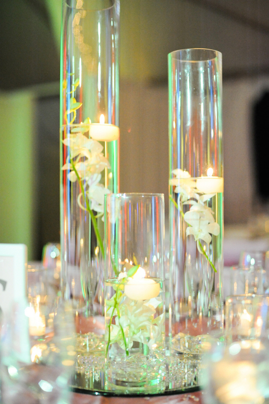 Hurricane Vases with Floating Candles and Flowers