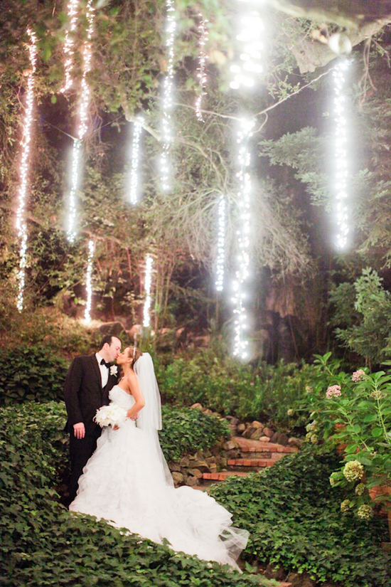 Ethereal Photograph of Newlyweds Under Twinkle Lights