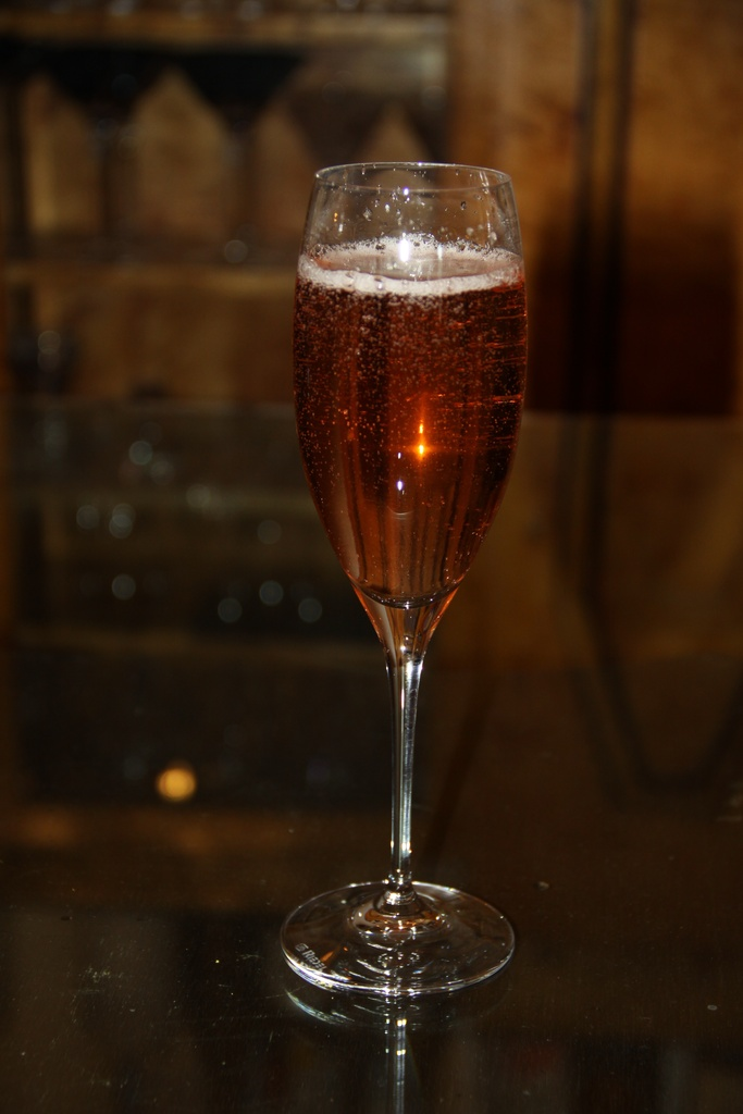 photo of This red cocktail in a champagne flute would be perfect for any red themed party.
